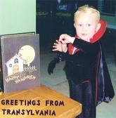 Baby wearing Dracula Halloween costume.