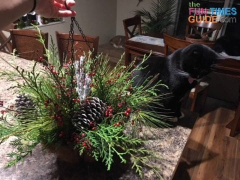 I added a white sparkly twig in the middle, as a centerpiece for these Christmas arrangements.