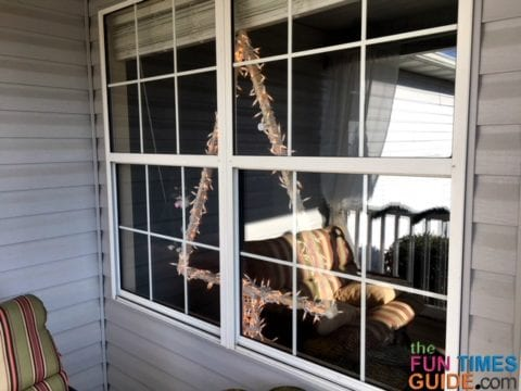 This DIY Christmas tree stands solidly in the window without additional anchoring.