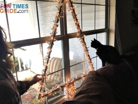 I wrapped some lights around a simple DIY Christmas tree frame to make a lighted window Christmas tree!
