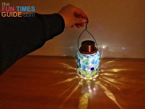 I really like the way the light is illuminated and displaced from the different colored gems on these DIY solar lanterns.